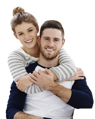 Smiling man and woman after preventive dentistry