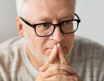 Man contemplating dental implant tooth replacement