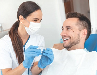 Dentist and patient discussing cost of Invisalign in Ellicott City