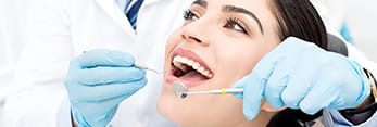Woman receiving preventive dentistry exam